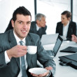 Stock Photo: Businessman in business ambience drinking cofee