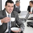 Стоковое фото: Businessmin business ambience drinking cofee