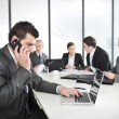 Businessman calling on phone, business meeting at background — Foto Stock