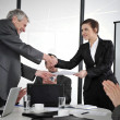 Happy business leaders handshaking at meeting — Stock Photo