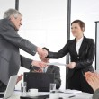 Happy business leaders handshaking at meeting — Stock Photo #26247615