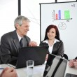 Business meeting - group of in office at presentation — Stock Photo