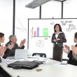 Stock Photo: Businesswoman drawing a diagram during the presentation