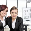 Portrait of two businesswomen in business presentation at office — Stock Photo