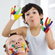 Kid and his mother playing with messy colors — Stock Photo #26248855