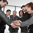 Stock Photo: Business partners hands on top of each other symbolizing companionship and unity