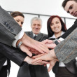 Foto Stock: Group of business with hands together for unity and partnership