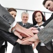 Foto de Stock  : Group of business with hands together for unity and partnership