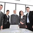 Group of business standing at office and smiling — Stock Photo #26249063