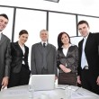 Stock Photo: Group of business standing at office and smiling