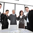 Group of business standing at office and holding each other — Stock Photo #26249083