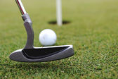 Golf Stick and Ball on the Green Grass — Stock Photo