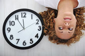 Blonde girl and clock — Stock Photo