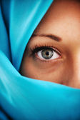 Half face in blue scarf — Stock Photo