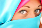 Young beautiful muslim woman in blue scarf — Stock Photo