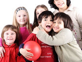 Group of happy playful children in studio — Stock Photo