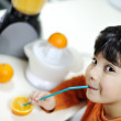 Little boy with orange — Stock Photo
