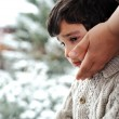 Sad kid on window and winter snow is outside — Stock Photo