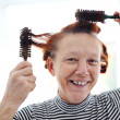 Senior lady hairdressing with many combs — 图库照片