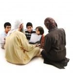 Teacher with children using laptop — Stock Photo