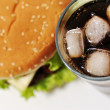 Cola with ice and burger — Foto Stock