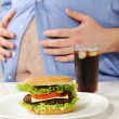 Fat stomach with burger and cola — Stock Photo #26253767