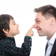Happy father and son playing finger nose — Stock Photo #26254303