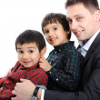 Portrait of happy father and two sons — Stock Photo