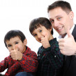 Portrait of happy father and two sons with thumbs up — Stock Photo #26254473