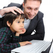 Father and son using laptop — Stock Photo