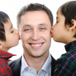 Two sons kissing father — Stock Photo #26254767