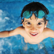 Stock Photo: Little boy at swimming pool