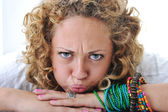 Teen girl with angry grimace — Stock Photo