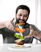 Adult man making a burger — Stock Photo