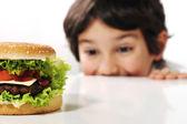 Kid and hamburger — Stock Photo