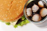 Cola with ice and burger — Stock Photo
