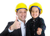Father and son as workers with thumb up — Stock Photo