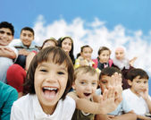 Crowd of children, different ages and races in front of the scho — Foto Stock