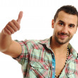 Happy casual young man showing thumb up and smiling isolated on white backg — Stock Photo #6186494