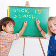 Educational activities in the front of small board, isolated — Stock Photo #8848740