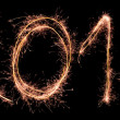 New Year 2014 made of real sparkles - Stock Photo