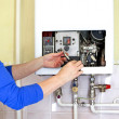 Stock Photo: Plumber gas heating