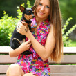 Young happy woman with her cute dog — Stok fotoğraf