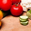 Different vegetables on wooden table - Stock Photo