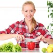 Young and happy girl preparing healthy food — Stock Photo #12791180
