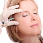 vrouw met gezicht injectie — Stockfoto