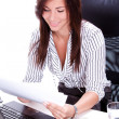 Business woman doing paperwork in the office — Stock Photo