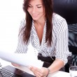 Business woman doing paperwork in the office — Stock Photo #12791305