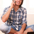 Happy and handsome using cell phone — Stock Photo