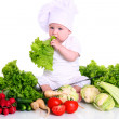 Cute baby chef with different vegetables — Stock Photo